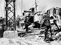 0131783 © Granger - Historical Picture ArchiveVIETNAM WAR: SAIGON, 1968.   South Vietnamese Marines moving through rubble in southern Saigon during fighting between Viet Cong sapper units and government forces, May 1968.