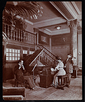 0163815 © Granger - Historical Picture ArchiveNEW YORK: AEOLIAN PLAYER.   Woman operating an Aeolian player piano. Photograph, c1900.