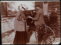 0163819 © Granger - Historical Picture ArchiveQUAIL SHOOTING, 1904.   A man and woman in front of a carriage with a shotgun in Aitken, South Carolina. Photograph, 1904.