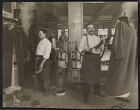 0163821 © Granger - Historical Picture ArchiveAMERICAN GAS APPLIANCE CO.   Men cleaning overcoats in New York City, 1913.
