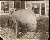 0163858 © Granger - Historical Picture ArchiveRACECAR, c1912.   Special racing car with driver parked in front of a Cadillac dealership.