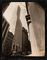 0163892 © Granger - Historical Picture ArchiveCONTINENTAL BANK BUILDING.   Photograph from the steps of the U.S. Subtreasury building on Wall Street, looking toward the Continental Bank Building at 30 Broad Street. Parked automobiles and adjacent buildings are visible, including Western Union, 1933.