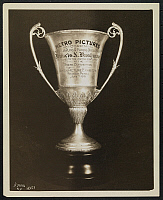 0163967 © Granger - Historical Picture ArchiveMETRO PICTURES TROPHY.   Engraved silver loving cup, presented to Francis X. Bushman by Metro Pictures Corporation at the State Convention of Motion Picture Exhibitors, Reading, Pennsylvania, June 7, 1915. Photograph.