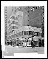 0164066 © Granger - Historical Picture ArchiveCHESEBROUGH BUILDING.   The Chesebrough building at 2-10 John Street at Broadway, with Horn & Hardart Automat and Fanny Farmer Candies, New York City. Photograph, 7 January 1940.