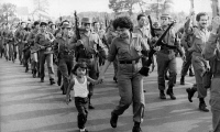 0621166 © Granger - Historical Picture ArchiveNICARAGUA: DEMONSTRATION, 1983. Sandinistan soldiers march through the streets of Managua, demosntrating against the US-supported Contras. Photograph, 20 May 1983. Full Credit: ullstein bild - ADN-Bildarchiv / Granger, NYC. All Rights Reserved.