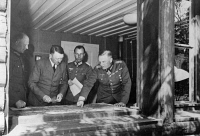 0633943 © Granger - Historical Picture ArchiveADOLF HITLER (1889-1945).  Chancellor of Germany, 1933-1945. At the Felsennest headquarters in Bad Muenstereifel during the German invasion of France. With him at a map table, left to right: Alfred Jodl, Willy Deyhle, and Wilhelm Keitel. Photograph, May 1940. Full Credit: Ullstein Bild / Granger. All Rights Reserved.