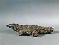 0273332 © Granger - Historical Picture ArchiveARCHAEOLOGY.   Egyptian civilization, Middle Kingdom, Dynasty XII. Bronze and nielloed electrum crocodile figure, circa 1850 b.C. From Faiyum. Full Credit: DEA / G. DAGLI ORTI / Granger, NYC -- All Rights Reserved.