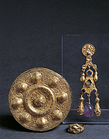 0274714 © Granger - Historical Picture ArchiveARCHAEOLOGY.   Italy, Marche, Castel Trosino, Fibula, earring and ring, goldsmithery 7th Century A.D., Italy, Rome, Museo Dell'alto Medioevo (Medieval Museum), Lombard civilization . Full Credit: DEA / A. DE GREGORIO / Granger, NYC -- All Rights Reserved.