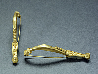 0274921 © Granger - Historical Picture ArchiveARCHAEOLOGY.   A pair of gold fibulas. Etruscan civilization, 9th-1st Century BC. Full Credit: DEA / A. DE GREGORIO / Granger, NYC -- All Rights Reserved.