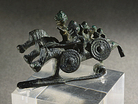 0277113 © Granger - Historical Picture ArchiveARCHAEOLOGY.   Bronze fibula depicting horsemen. Artefact from the Benvenuti Tomb in Este (Veneto). Etruscan civilization, 7th Century BC. Full Credit: DEA / G. DAGLI ORTI / Granger, NYC -- All Rights Reserved.