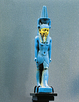 0278057 © Granger - Historical Picture ArchiveARCHAEOLOGY.   Egyptian civilization. Faience amulet figurine of Nefertem, god associated with the water and the lotus flower, with a water-lily headdress. Full Credit: DEA / G. DAGLI ORTI / Granger, NYC -- All rights reserved.