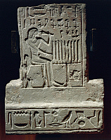 0278463 © Granger - Historical Picture ArchiveARCHAEOLOGY.   Egyptian civilization, Protodynastic Period. Small funerary stele depicting the deceased with lotus flowers. At the bottom, hieroglyphs. From Saqqara. Full Credit: DEA / A. DAGLI ORTI / Granger, NYC -- All rights reserved.