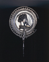 0278705 © Granger - Historical Picture ArchiveARCHAEOLOGY.   Roman civilization, 1st century A.D. Silver circular mirror with decorated frame. In the backside of the mirror, Apollonian female figure emblem, spindle-shaped handle. From Pompei. Full Credit: DEA / L. PEDICINI / Granger, NYC -- All Rights Reserved.