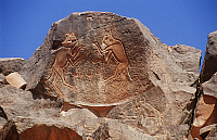 0282312 © Granger - Historical Picture ArchiveARCHAEOLOGY.   Libya - Sahara Desert - Fezzan - Wadi Mathendush archaeological site. Rock engravings depicting fighting cats. Full Credit: DEA / C. SAPPA / Granger, NYC -- All righ