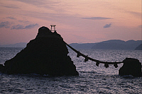 0284299 © Granger - Historical Picture ArchiveART & ARCHITECTURE.   Japan - The coast off Futami - Meoto Iwa, or the 'wedded rocks' representing Shintoist divinities and tied together by a ceremonial rope. Full Credit: DEA / G. SIOEN / Granger, NYC -- All rights reserved.