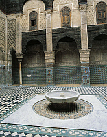 0285950 © Granger - Historical Picture ArchiveART & ARCHITECTURE.   Interior area with marble basin for ablutions, Medersa El-Attarin, Merinid period (1323-1325), Fes. Morocco. Full Credit: DEA / G. DAGLI ORTI / Granger, NYC -- All Rights Reserved.