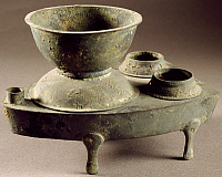 0288846 © Granger - Historical Picture ArchiveASIAN ART.   Oven with a Hein pot to cook steamed rice, bronze model, China. Chinese Civilisation, Han Dynasty, 1st century. Full Credit: DEA / G. DAGLI ORTI / Granger, NYC -- All Rights Reserved.