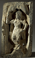 0288996 © Granger - Historical Picture ArchiveASIAN ART.   Buddhist with Yakshini or vegetation genius, shale Greek sculpture, Afghanistan. Gandhara Civilisation, 1st century BC- 3rd century AD. Full Credit: DEA / G. DAGLI ORTI / Granger, NYC -- All rights reserved.