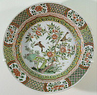 0289426 © Granger - Historical Picture ArchiveASIAN ART.   Plate decorated with flowers and birds, famille verte (green family) ceramic, China. Chinese Civilisation, Qing dynasty, beginning of Kangxi period, 17th-18th century. Full Credit: DEA / G. DAGLI ORTI / Granger, NYC -- All righ