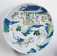 0289434 © Granger - Historical Picture ArchiveASIAN ART.   Large plate decorated with figures of women in a pagoda and, at the base, the poet Li Po sitting on a tree branch, famille verte (green family) ceramic, China. Chinese Civilisation, Qing dynasty, beginning of Kangxi reign, 17th century. Full Credit: DEA / G. DAGLI ORTI / Granger, NYC -- All Rights Reserved.
