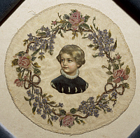 0292794 © Granger - Historical Picture ArchiveDECORATIVE ARTS.   Embroidery, 19th century. Silk crown, embroidered in small stitch on tulle, with roses and forget-me-not and central paper figure of a child. Full Credit: DEA / A. DAGLI ORTI / Granger, NYC -- All rights reserved.