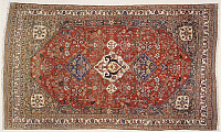 0293022 © Granger - Historical Picture ArchiveDECORATIVE ARTS.   Rugs and Carpets: Iran - Fars province - 19th century. Woollen Qashqai carpet with a central medallion representing the 'Kharchanghi' tribal symbol. Full Credit: DEA PICTURE LIBRARY / Granger, NYC -- All rights reserved.