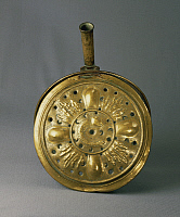 0293444 © Granger - Historical Picture ArchiveDECORATIVE ARTS.   Goldsmith's art, Italy, 17th century. Brass warming pan from Lombardy region. Full Credit: DEA / GENNI CAPPELLI / Granger, NYC -- All rights reserved.