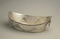 0293450 © Granger - Historical Picture ArchiveDECORATIVE ARTS.   Silversmith's Art, England 20th century. Boat-shaped, pierced and embossed sheffield plate basket, approximately 1900's. Full Credit: DEA / G. CIGOLINI / Granger, NYC -- All Rights Reserved.