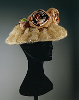 0293976 © Granger - Historical Picture ArchiveDECORATIVE ARTS.   Fashion, 20th century. Women's cloche oriental straw hat ornamented with tulle, net, satin roses wax fabric leaves and papier-mache' fruits, around 1960. Full Credit: DEA / A. DAGLI ORTI / Granger, NYC -- All rights reser