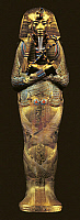0320720 © Granger - Historical Picture ArchiveANCIENT EGYPT.   Egyptian Art, Dynasty 18 (1550-1291 BC). 'Treasures of Tutankhamun'. Inner coffin of gold, semiprecious stones and vitreous pastes. Pharaoh as Osiris has arms crossed on breast holding crook and flail. Striped headdress 'nemes' has central symbolic vulture and cobra, representing protectors of Upper and Lower Egypt respectively goddesses Nek