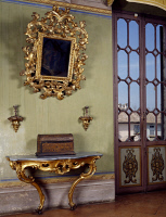 0331465 © Granger - Historical Picture ArchiveART & ARCHITECTURE.   Mirror with candle holders and French side table, Rocca Sanvitale, Fontanellato, near Parma, Emilia-Romagna. Italy. Full credit: De Agostini / G. Cigolini / Granger, NYC -- All Rights Reserved.