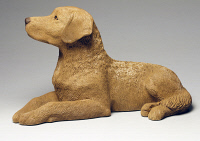 0334712 © Granger - Historical Picture ArchiveDECORATIVE ARTS.   Chesapeake Bay Retriever, by Sandra Brue, ceramic, Sandicast manufacture, San Diego, California. United States, 20th century. Full credit: De Agostini / G. Cigolini / Granger, NYC -- All rights reserved.