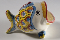 0335556 © Granger - Historical Picture ArchiveDECORATIVE ARTS.   Fish decorated with an 18th-century style peacock tail motif in blue, yellow and orange, ceramic, Salvatore Gurreri manufacture, Caltagirone, Sicily. Italy, 20th century. Full credit: De Agostini / A. Dagli Orti / Granger, NYC -- All Rights Reserved.