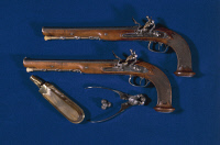0340240 © Granger - Historical Picture ArchiveHISTORY.   Pair of flintlock pistols from the Directory era, 1796, with balls, gunpowder holder and pliers. France, 18th century. Full credit: De Agostini Picture Library / Granger, NYC -- All Rights Reserved.