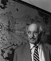 0165449 © Granger - Historical Picture ArchiveSIMON WIESENTHAL (1908-2005).   Austrian engineer and Nazi hunter. Wiesenthal in his office at Vienna, Austria, in front of a map showing the places of persecution of Jews under the Third Reich. Photographed by Horst Tappe, 1983.