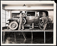 0163614 © Granger - Historical Picture ArchiveAUTOMOBILE MECHANICS, 1928.   Two mechanics working on a Nash auto at the Warren-Nash Motor Corp, 1928.