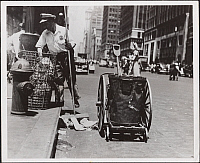 0165997 © Granger - Historical Picture ArchiveNEW YORK: STREET CLEANER.   Street cleaner in New York City. Photograph, 1944.