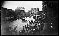 0166027 © Granger - Historical Picture ArchiveNEW YORK: NEAR CITY HALL.   Crowded street near City Hall, New York City. Trolley, horse-drawn carriage and statue of Benjamin Franklin are visible. Photograph, c1900.