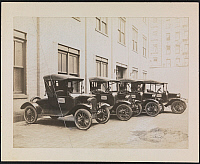 0166092 © Granger - Historical Picture ArchiveMODEL T FORDS.   Fleet of four Model T Fords parked outside behind a building for salesmen of 'Peter Doelger's Healthful Beverage.' Photograph, c1917.