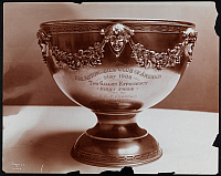0166116 © Granger - Historical Picture ArchiveSILVER TROPHY, 1906.   Silver trophy cup engraved: 'The Automobile Club of America, May 1906, Two Gallon Efficiency, First Prize, Won By 12 H.P. Franklin, 87 Miles.' Photograph, 1906.