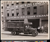 0166125 © Granger - Historical Picture ArchiveDELIVERY TRUCK, c1915.   A delivery truck with driver and passenger in front of William J. Lemp Brewing Company Shippers and Travelers' Exchange building. 'Falstaff Bottled Beer' and 'Wm. J. Lemp Brewing Co., St. Louis, Mo.' painted on a broadside. Photograph, probably New York City, c1915.