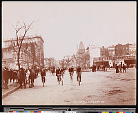 0166165 © Granger - Historical Picture ArchiveBICYCLISTS ON BROADWAY.   Sidewalk crowded with spectators as bicyclists ride along Broadway at 59th Street, New York City. Photograph, 1898.