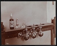 0166242 © Granger - Historical Picture ArchiveBEER TAPS, 1899.   Close up of bar taps in a cafe with a bottle of whiskey. New York City, photograph, 1899.