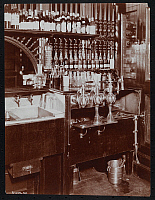 0166246 © Granger - Historical Picture ArchiveBAR SERVICE AREA.   Service area in a bar with bottles and decanters of wine and liquor. Photograph, c1895.