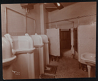 0166251 © Granger - Historical Picture ArchiveC.R. WESSELS SALOON.   Men's restroom at C.R. Wessels Saloon (possibly in Jersey City) with urinals, pedestal sink, and toilet stalls. Photograph, 1905.