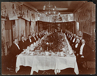 0166364 © Granger - Historical Picture ArchiveNEW YORK: BANQUET, c1903.   Men seated at a large table in a banquet room at a dinner with large cartoons, some political, hanging on the walls, New York City. Photograph, c1903.