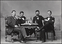 0166375 © Granger - Historical Picture ArchiveFOUR MEN SEATED, c1890.   Portrait of four men seated at a table. Photograph, c1890.