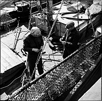 0172115 © Granger - Historical Picture ArchiveWATERFRONT, 1937.   Men working on a boat. New York City.