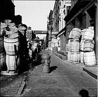 0172123 © Granger - Historical Picture ArchiveWATERFRONT, 1937.  Barrels lining a sidewalk in New York City.
