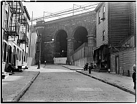 0172174 © Granger - Historical Picture ArchiveHOUSE NEAR BRIDGE, 1935.   Wooden house near a bridge, probably Front Street, in New York City.